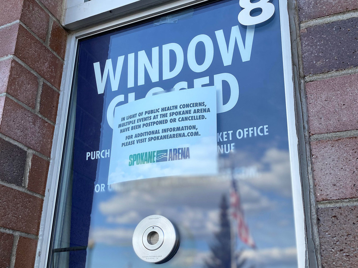 A ticket window outside Spokane Arena carries news of event cancellations due to COVID-19.