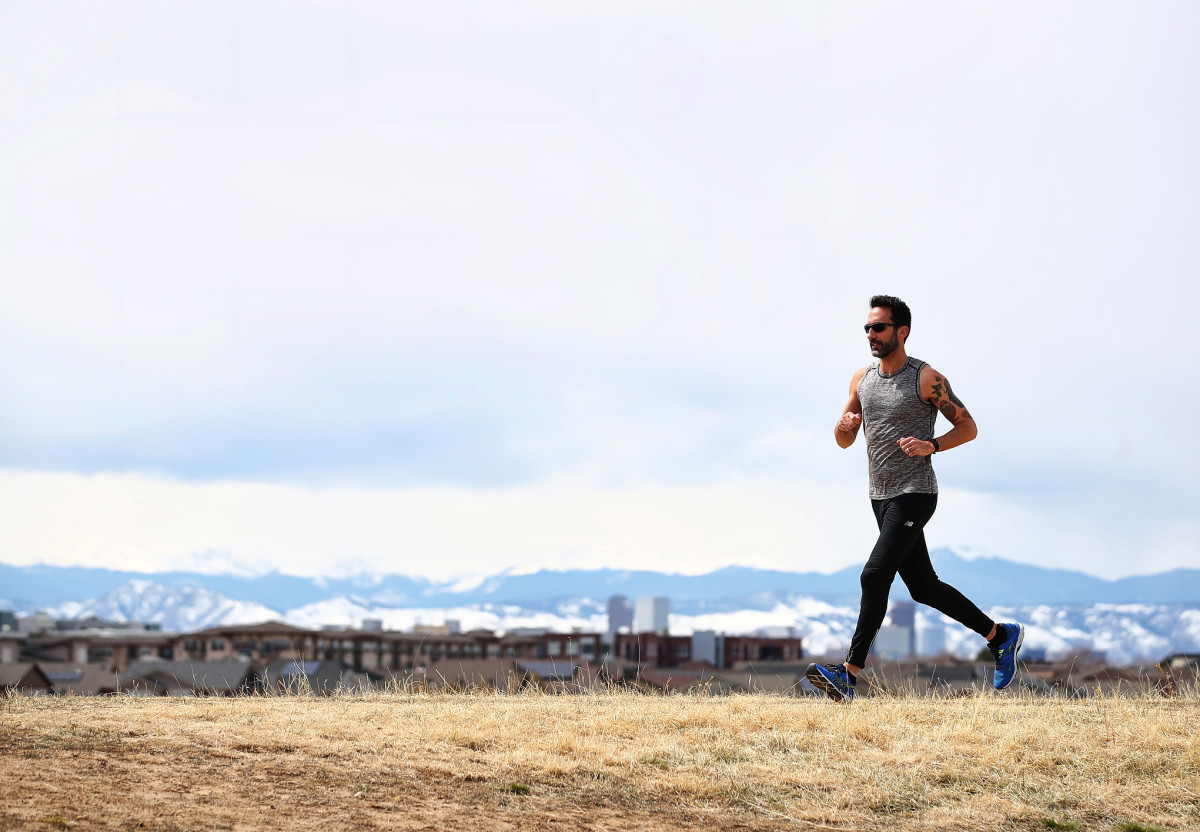 With most of the city on lockdown, a runner sets out to log miles in Central Park in Denver, Co., in mid-March.