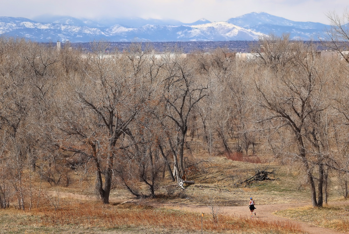 A runner hits the trails atBluff Lake Nature Center in Denver, Co., in mid-March.