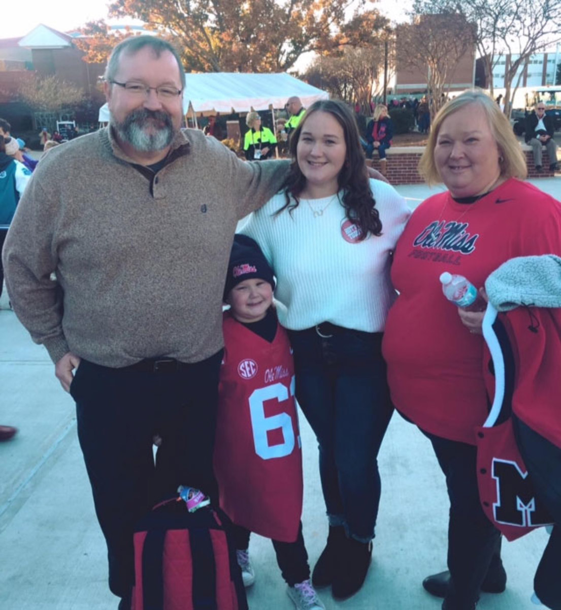 The parents and sisters of Ole Miss center Eli Johnson.