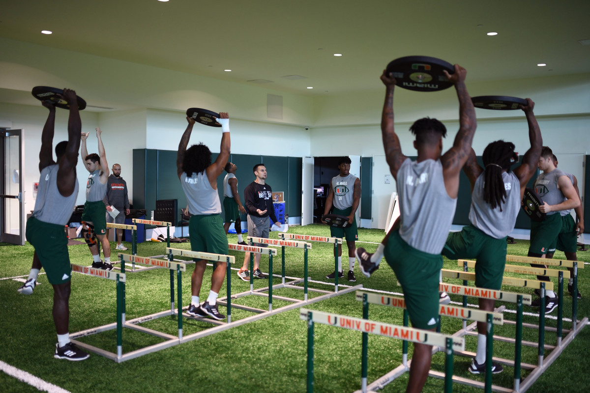 High-level athletes, like those on the Miami football team, usually work closely with trainers and staff. Now, they can only interact through a screen.