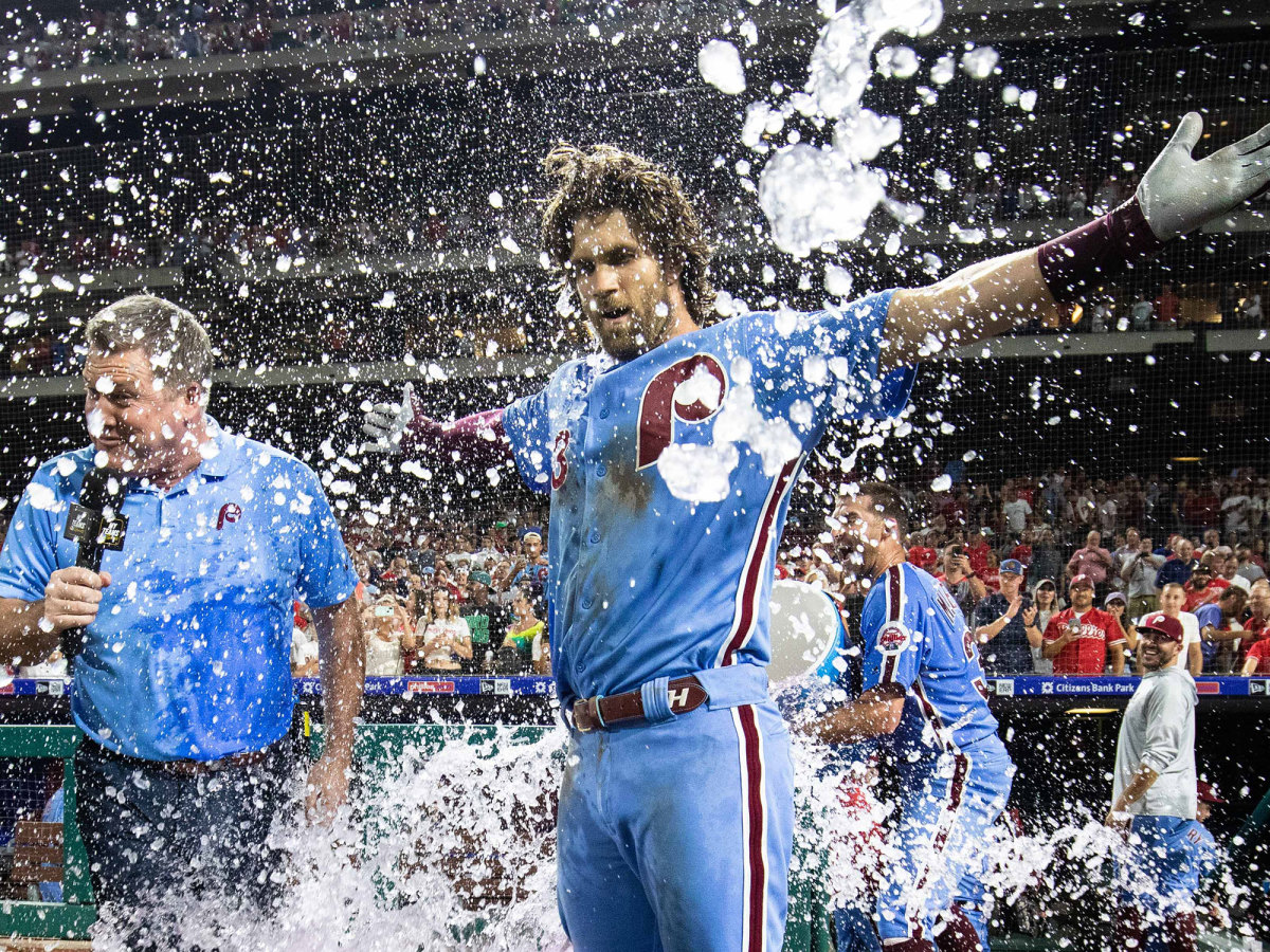 Bryce Harper doused with water