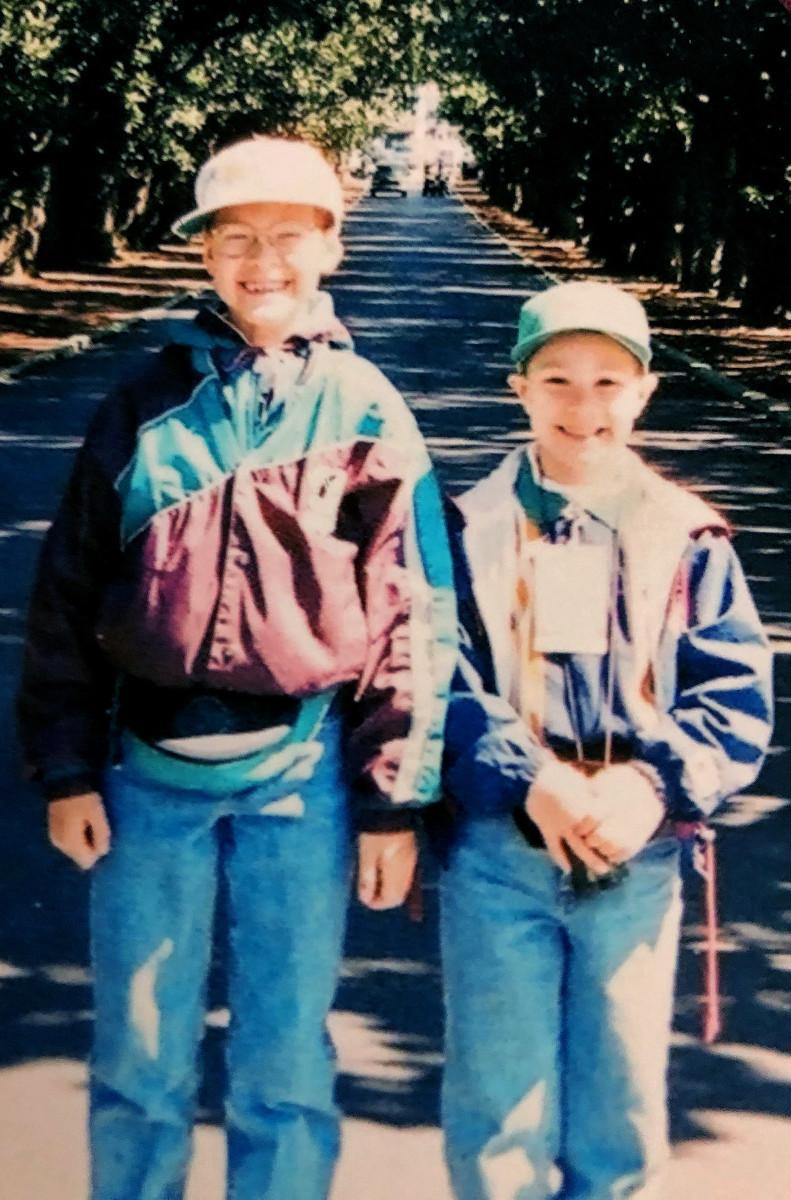 Daniel III (left) and Chris walk Magnolia Lane at Augusta.