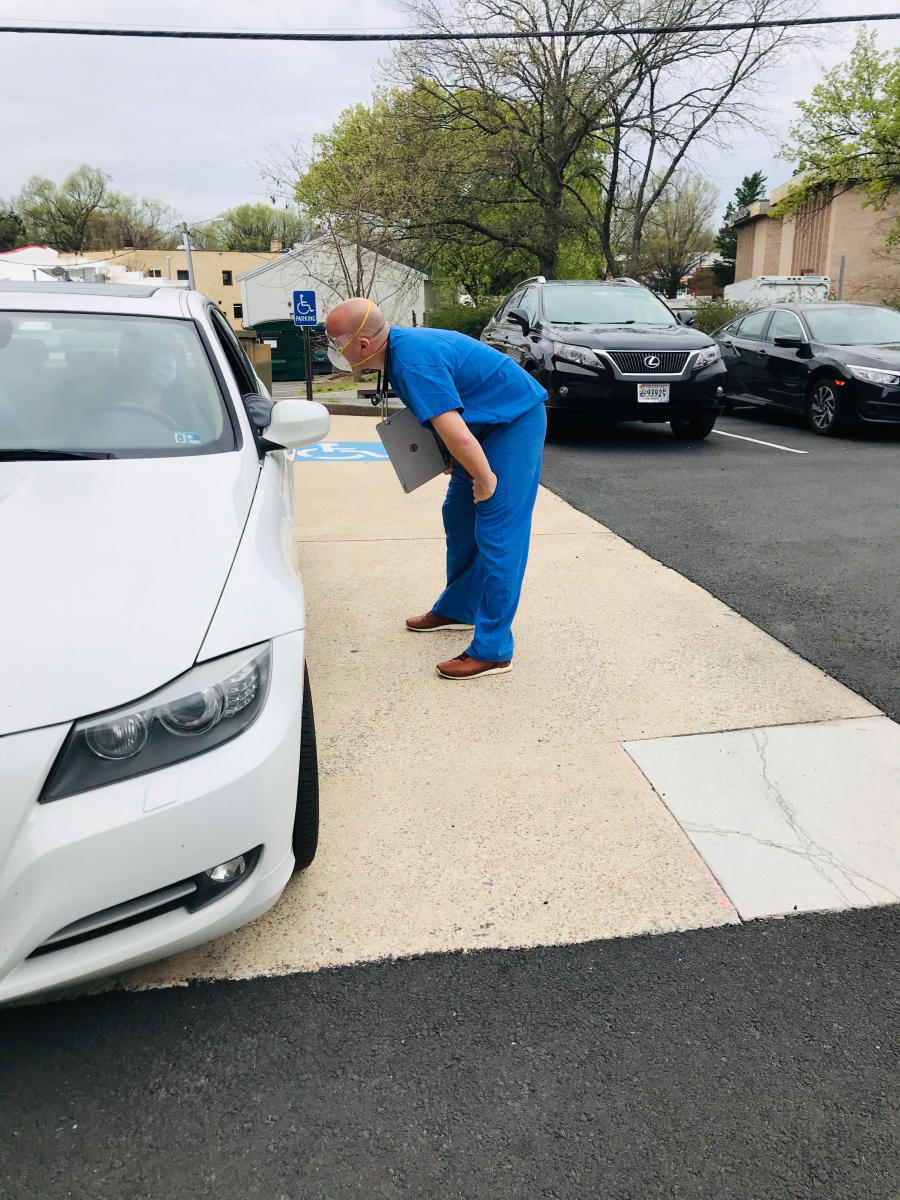 John Tabacco, a team doctor for Washington, is now doing curbside check-ups of people who drive up with potential COVID-19 symptoms.