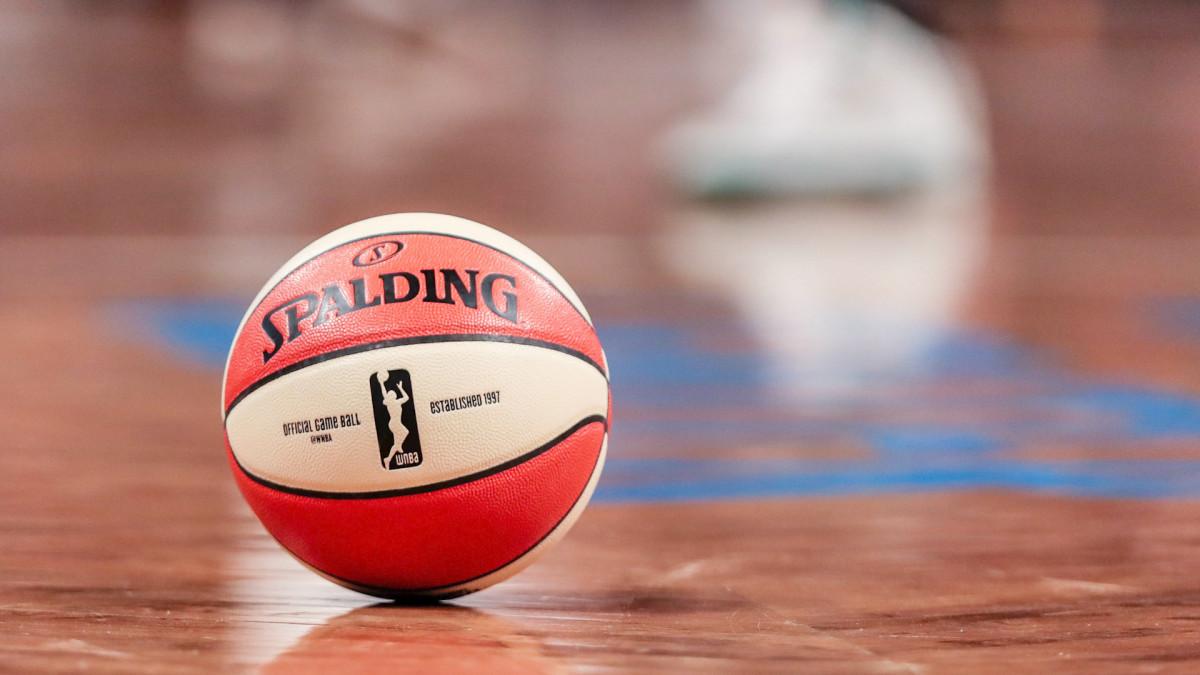 An orange and white Spalding basketball