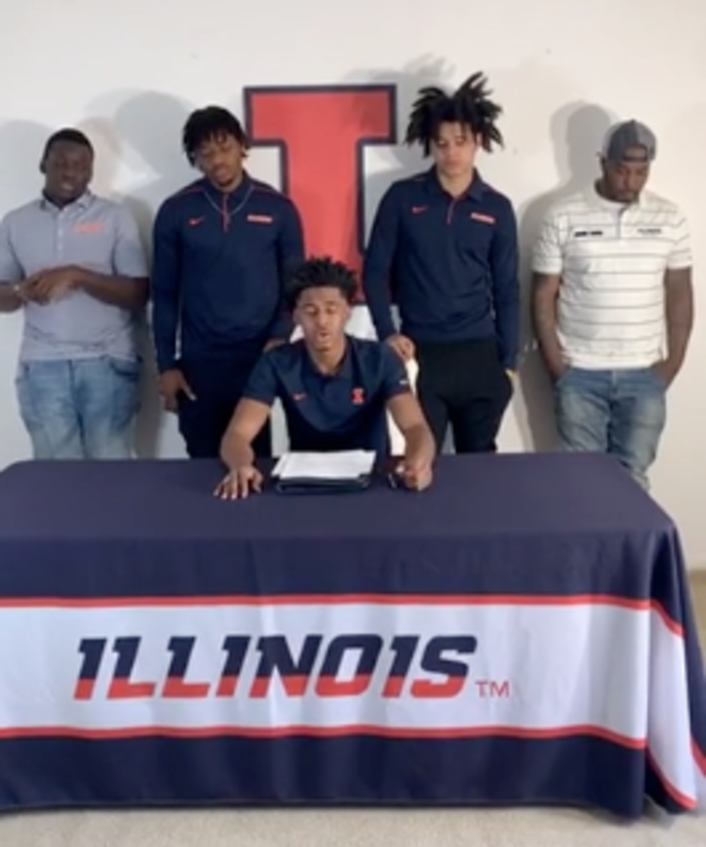 Adam Miller (middle) signs his National Letter-of-Intent with Illinois on April 22, 2020 in front of friends and family via a Instagram Live video.