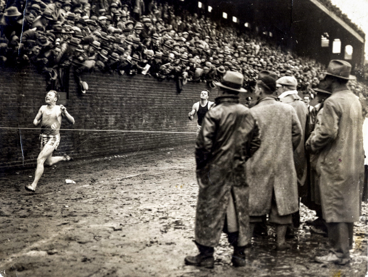 In 1928, Charley Paddock dodged fans who'd fallen onto the track, then he took the 175-yard sprint.