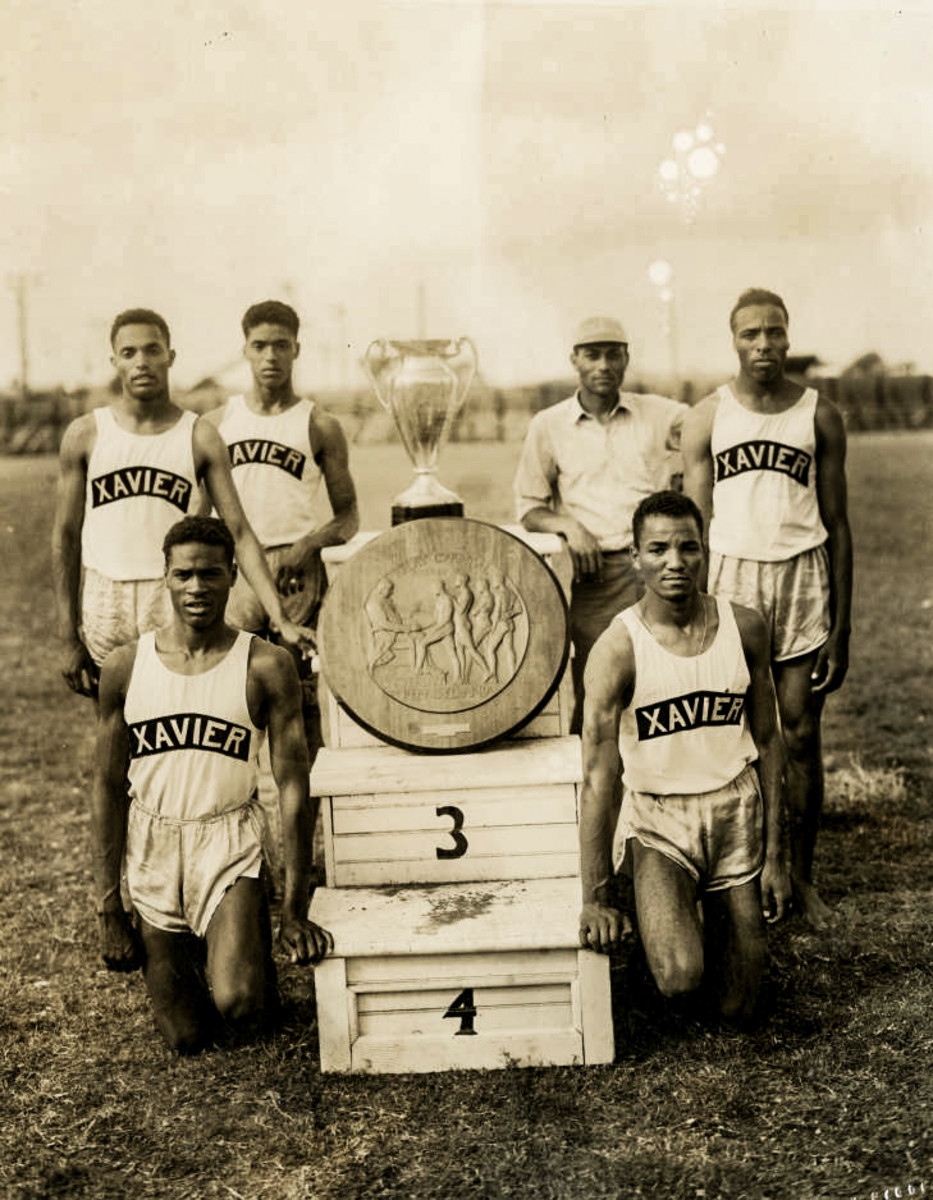 Douglas (front left) and his 4x110-champion teammates, in 1942.