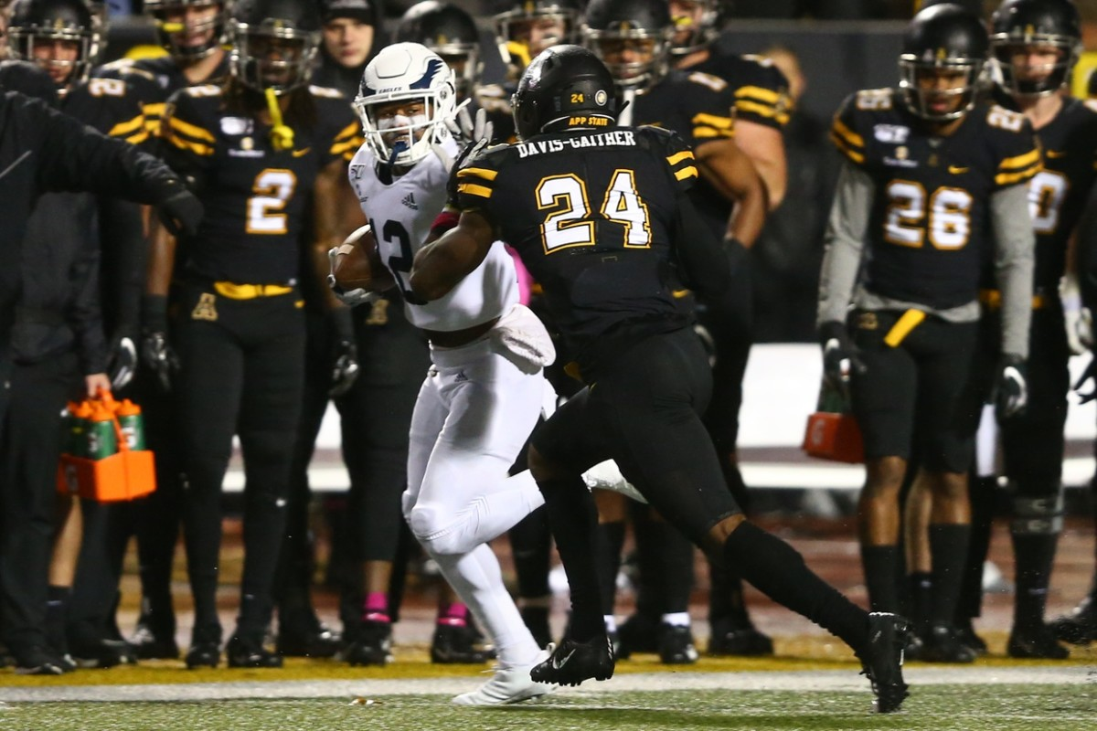 Oct 31, 2019; Boone, NC, USA; Georgia Southern Eagles running back Logan Wright (2) stiff arms Appalachian State Mountaineers linebacker Akeem Davis-Gaither (24) during the first quarter at Kidd Brewer Stadium. Mandatory Credit: Jeremy Brevard-USA TODAY Sport