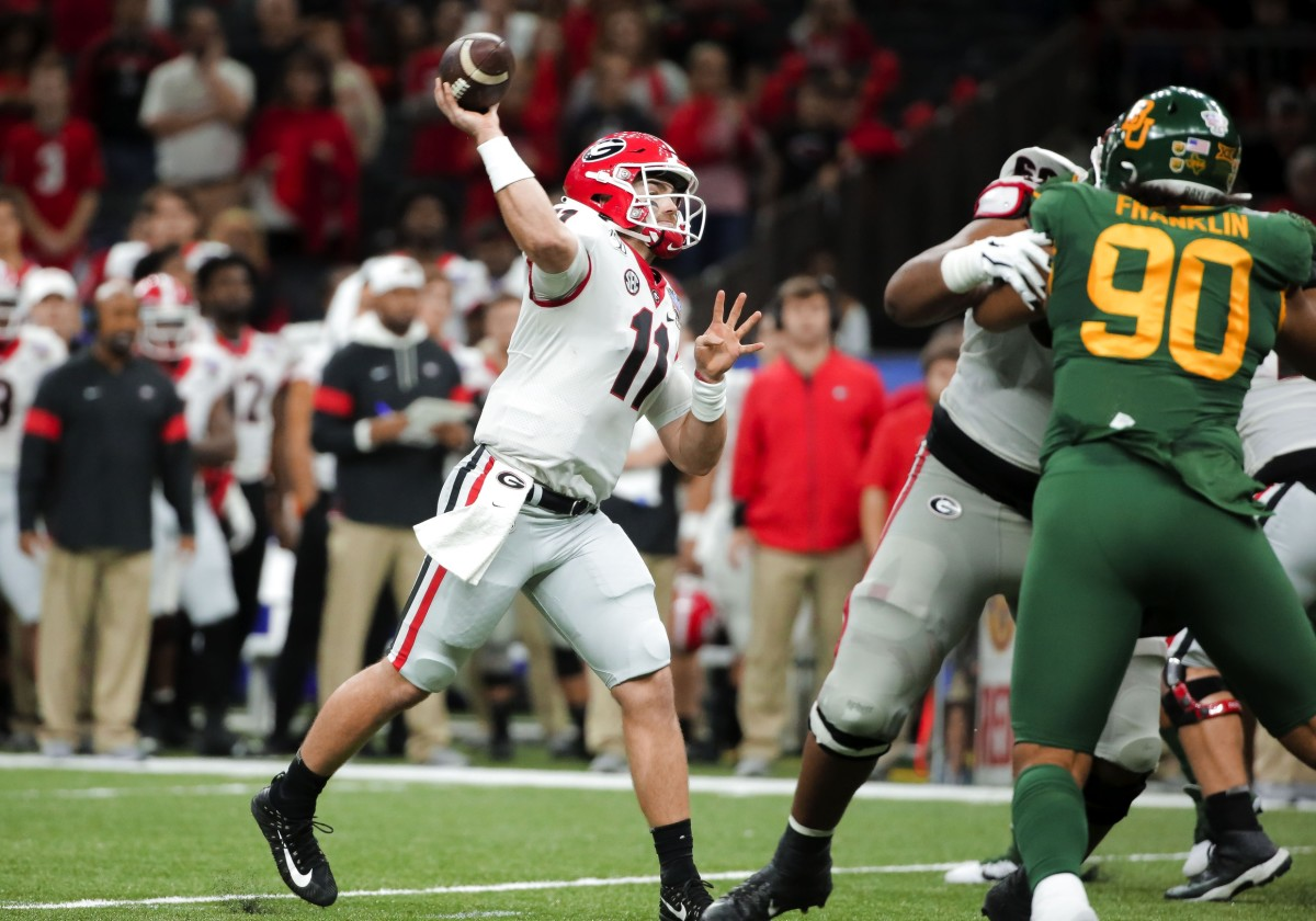 Jan 1, 2020; New Orleans, Louisiana, USA; Georgia Bulldogs quarterback Jake Fromm (11) throws a touchdown against the Baylor Bears during the second quarter at the Mercedes-Benz Superdome. Mandatory Credit: Derick E. Hingle-USA TODAY Sports