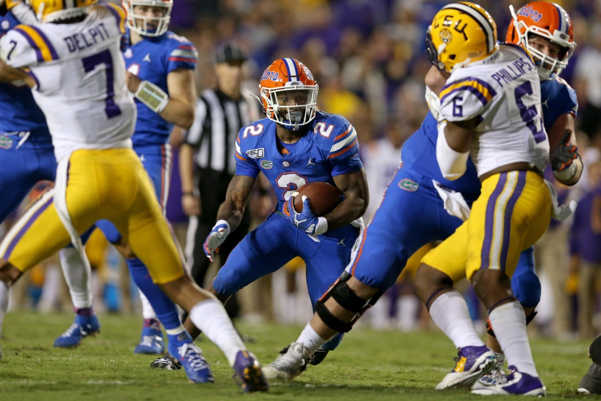 Oct 12, 2019; Baton Rouge, LA, USA; Florida Gators running back Lamical Perine (2) runs the ball against the LSU Tigers in the second half at Tiger Stadium. Mandatory Credit: Chuck Cook-USA TODAY Sport