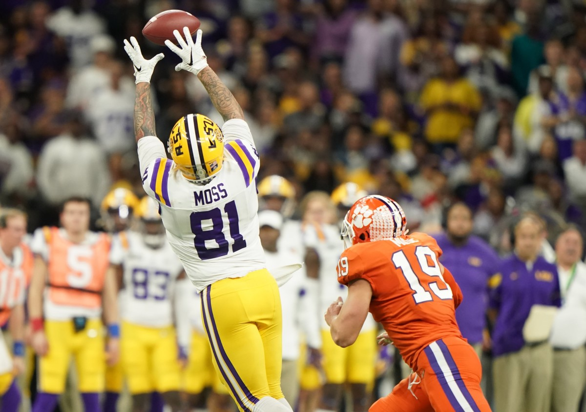 Jan 13, 2020; New Orleans, Louisiana, USA; LSU Tigers tight end Thaddeus Moss (81) makes a catch against Clemson Tigers safety Tanner Muse (19) in the fourth quarter in the College Football Playoff national championship game at Mercedes-Benz Superdome. Mandatory Credit: John David Mercer-USA TODAY Sports