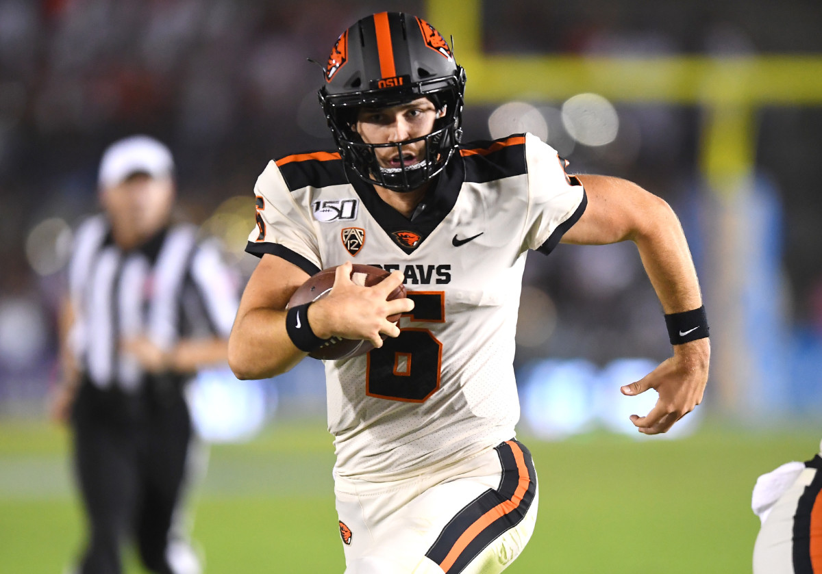 Oct 5, 2019; Pasadena, CA; Oregon State Beavers quarterback Jake Luton (6) runs for a touchdown against the UCLA Bruins at the Rose Bowl. Mandatory Credit: Jayne Kamin-Oncea-USA TODAY Sports