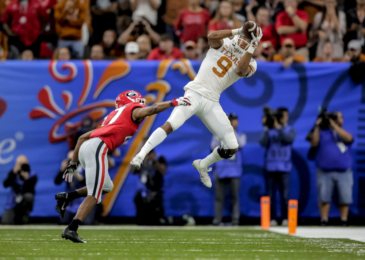 Jan 1, 2019; New Orleans, LA; Texas Longhorns wide receiver Collin Johnson (9) catches a pass over Georgia Bulldogs defensive back Eric Stokes (27) during the 2019 Sugar Bowl at Mercedes-Benz Superdome. Mandatory Credit: Derick E. Hingle-USA TODAY Sports