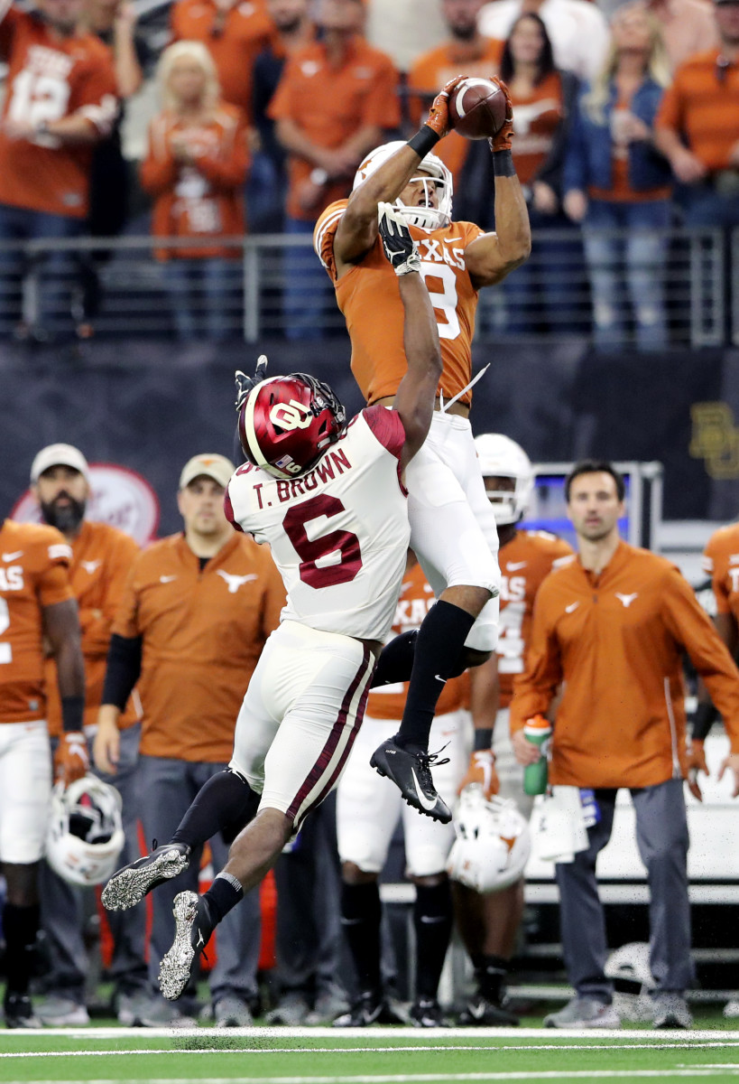 Dec 1, 2018; Arlington, TX; Texas Longhorns wide receiver Collin Johnson (9) makes a catch on Oklahoma Sooners cornerback Tre Brown (6) during the Big 12 Championship game at AT&T Stadium. Mandatory Credit: Kevin Jairaj-USA TODAY Sports