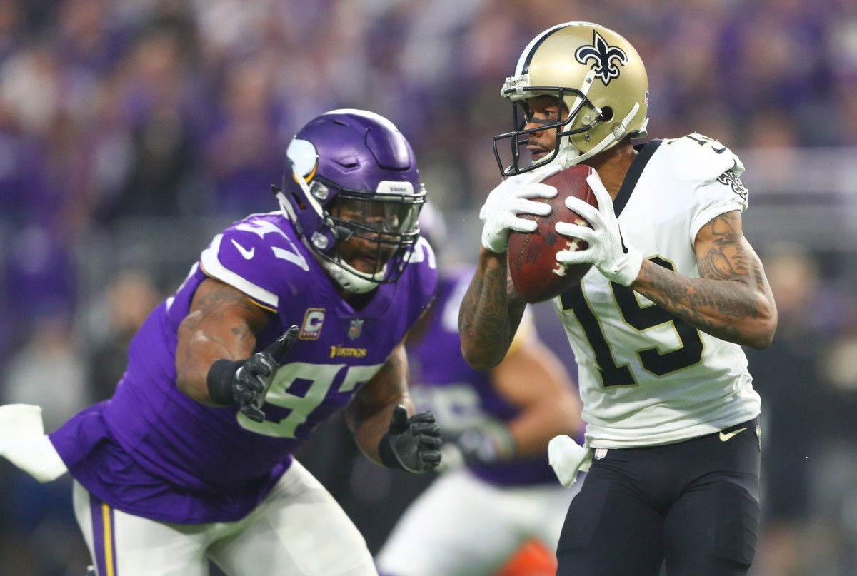Jan 14, 2018; Minneapolis, MN, USA; New Orleans Saints wide receiver Ted Ginn (19) runs the ball past Minnesota Vikings defensive end Everson Griffen (97) in the first quarter of the NFC Divisional Playoff football game at U.S. Bank Stadium. Mandatory Credit: Mark J. Rebilas-USA TODAY Sports