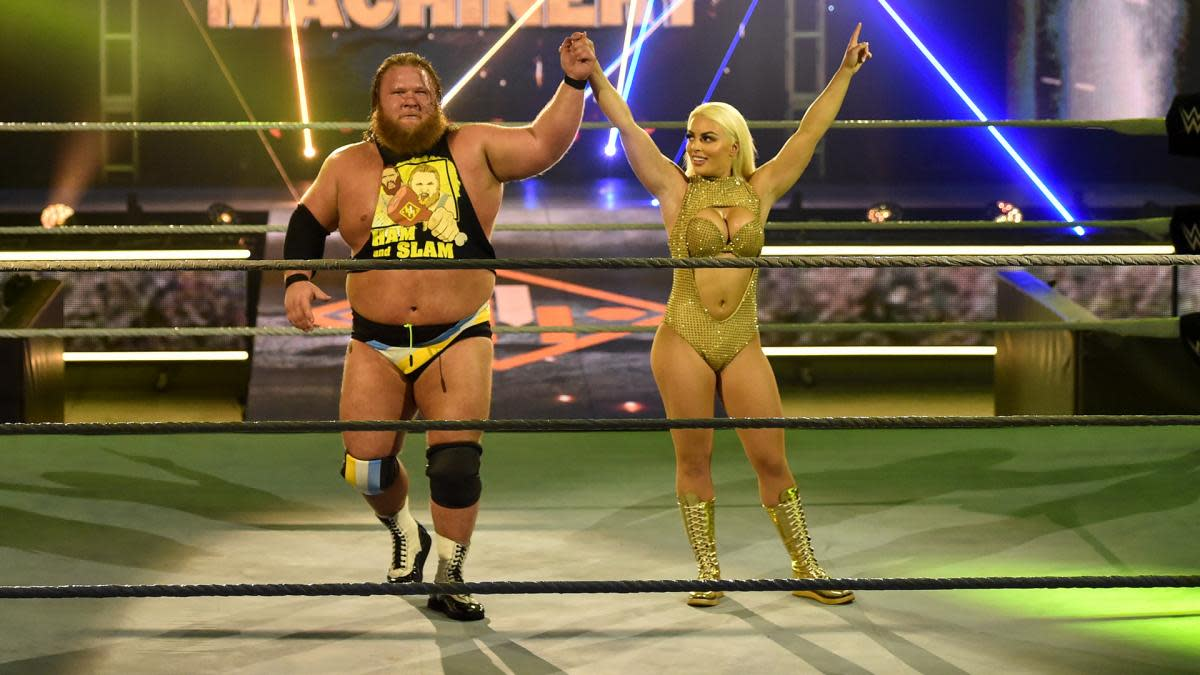 WWE's Mandy Rose and Otis celebrate in the ring at WrestleMania 36