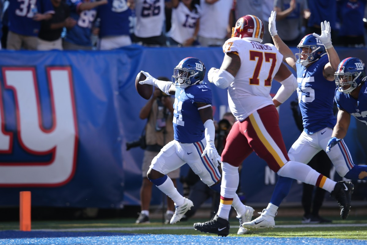 Sep 29, 2019; East Rutherford, NJ, USA; New York Giants safety Jabrill Peppers (21) runs an interception for a touchdown against the Washington Redskins during the third quarter at MetLife Stadium.