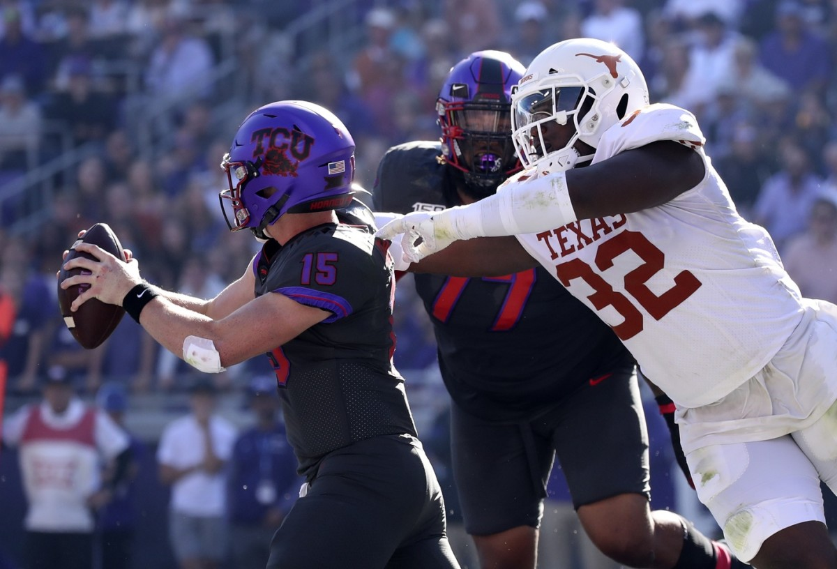 Oct 26, 2019; Fort Worth, TX, USA; Texas Longhorns defensive lineman Malcolm Roach (32) chases TCU Horned Frogs quarterback Max Duggan (15) during the second quarter at Amon G. Carter Stadium. Mandatory Credit: Kevin Jairaj-USA TODAY Sports
