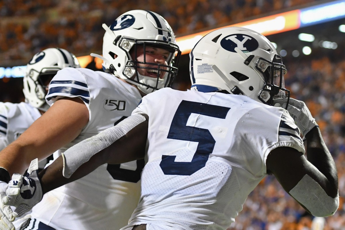 Ty'son WIlliams and James Empey celebrate BYU Football victory over Tennessee Volunteers