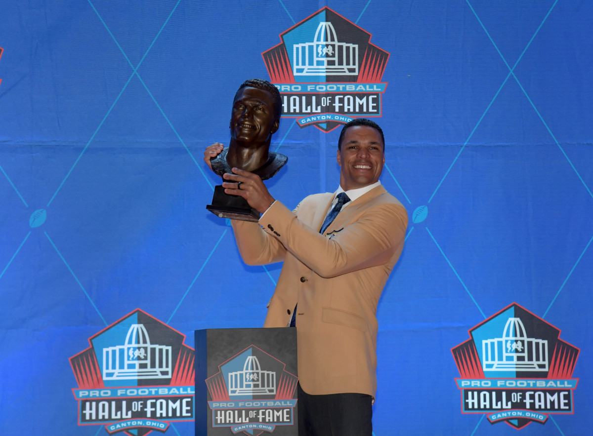 Aug 3, 2019; Canton, OH, USA; Tony Gonzalez poses with bust during the Pro Football Hall of Fame Enshrinement at Tom Benson Hall of Fame Stadium.