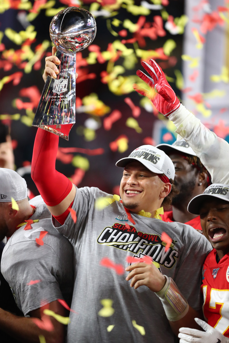 Chiefs quarterback Patrick Mahomes (15) celebrates with the Vince Lombardi Trophy after defeating the 49ers in Super Bowl LIV at Hard Rock Stadium.