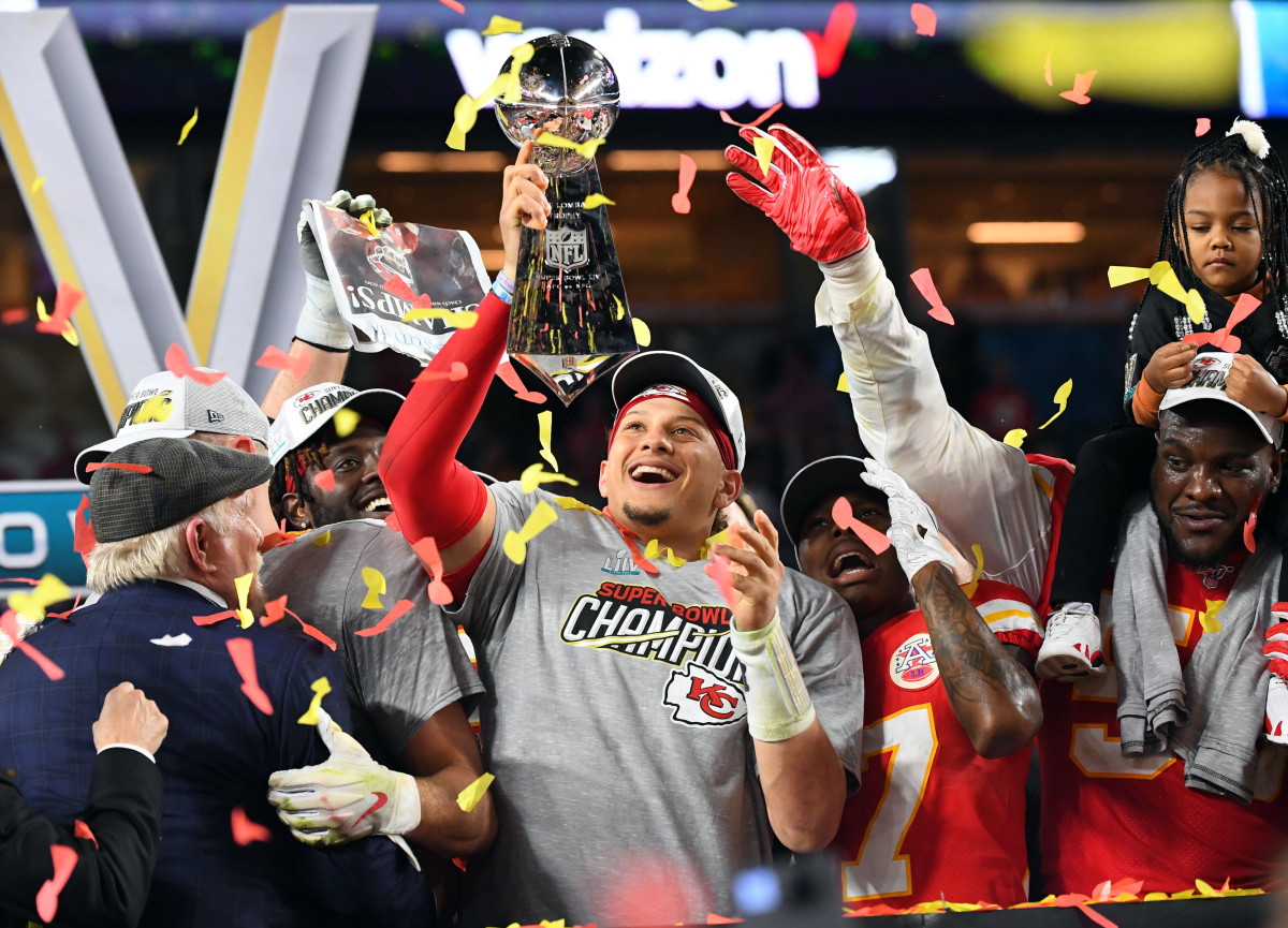 Chiefs quarterback Patrick Mahomes (15) hoists the Vince Lombardi Trophy after defeating the 49ers in Super Bowl LIV at Hard Rock Stadium.