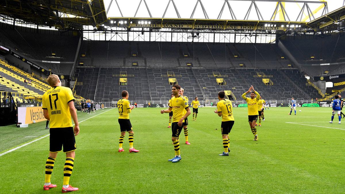 Erling Haaland celebrates his goal for Dortmund vs. Schalke
