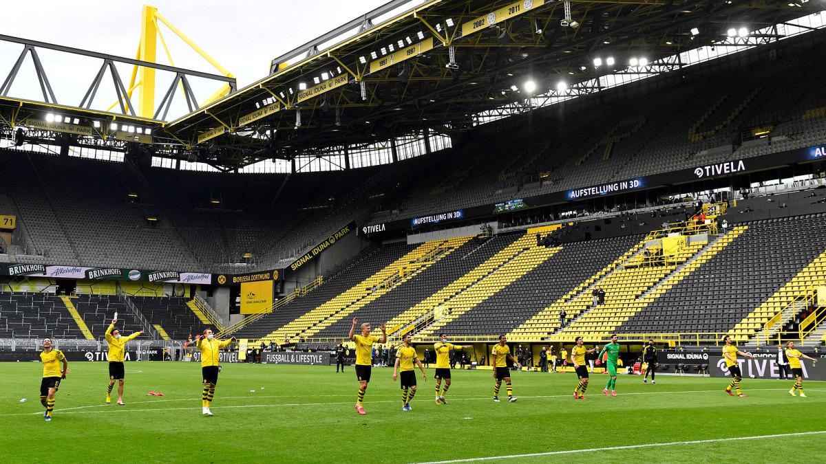 Dortmund players salute the empty Yellow Wall at Signal Iduna Park