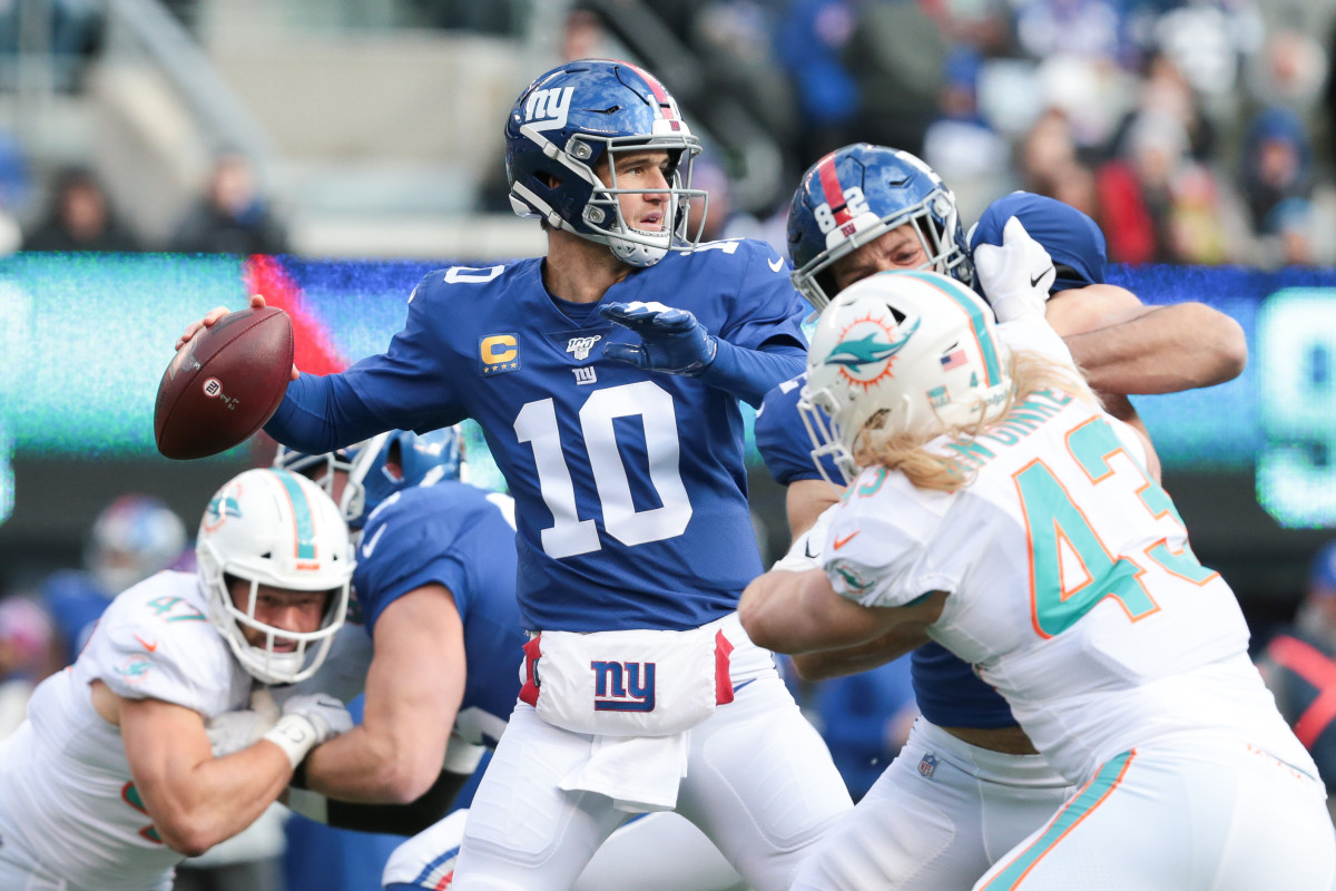 Giants quarterback Eli Manning (10) throws a pass during a 2019 game as Giants tight end Kaden Smith (82) defends at MetLife Stadium.