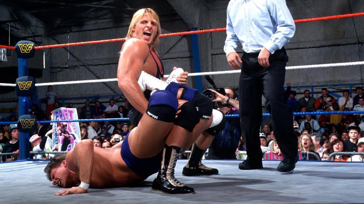 WWE's Owen Hart applies the Sharpshooter in the ring