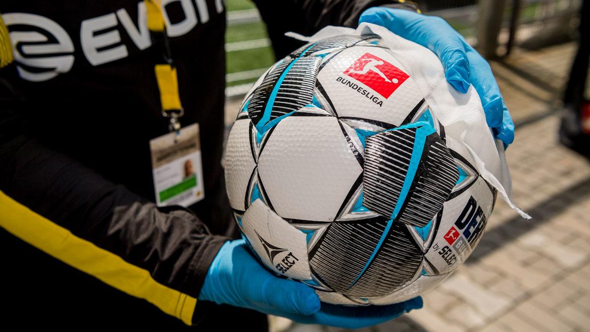 The game ball gets wiped before Dortmund vs. Schalke