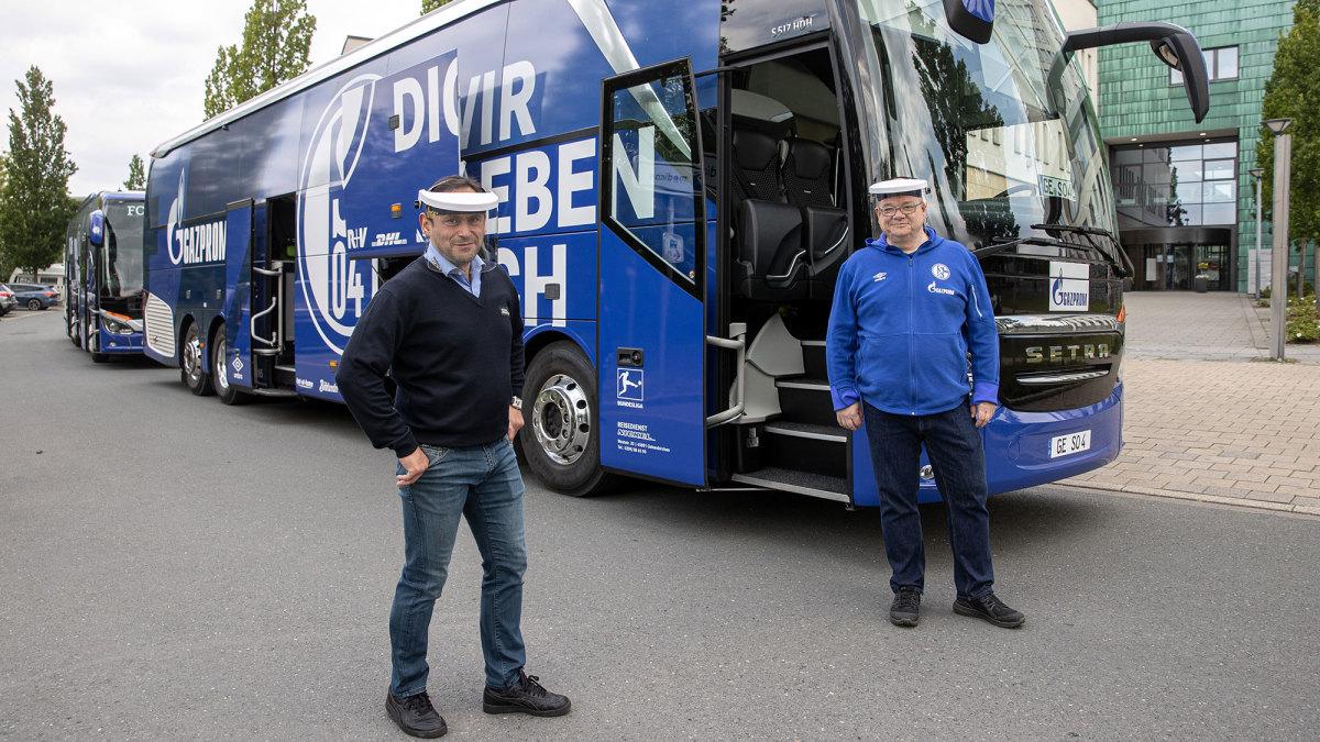 Schalke bus stewards wearing plastic masks