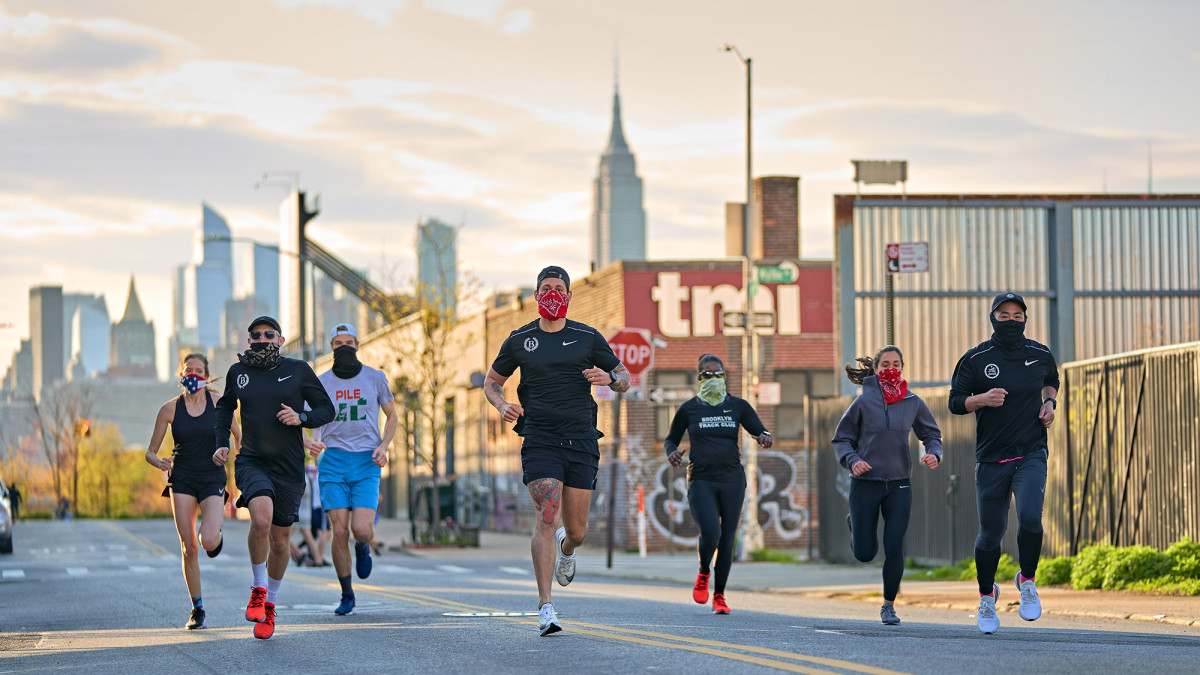 One of the few approved reasons for going outside in recent months is to get exercise, as mask-wearing members of the Brooklyn Track Club do.undefined
