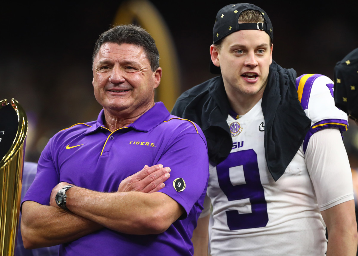 LSU Tigers head coach Ed Orgeron (left) with quarterback Joe Burrow after defeating the Clemson Tigers in the College Football Playoff national championship game at Mercedes-Benz Superdome.