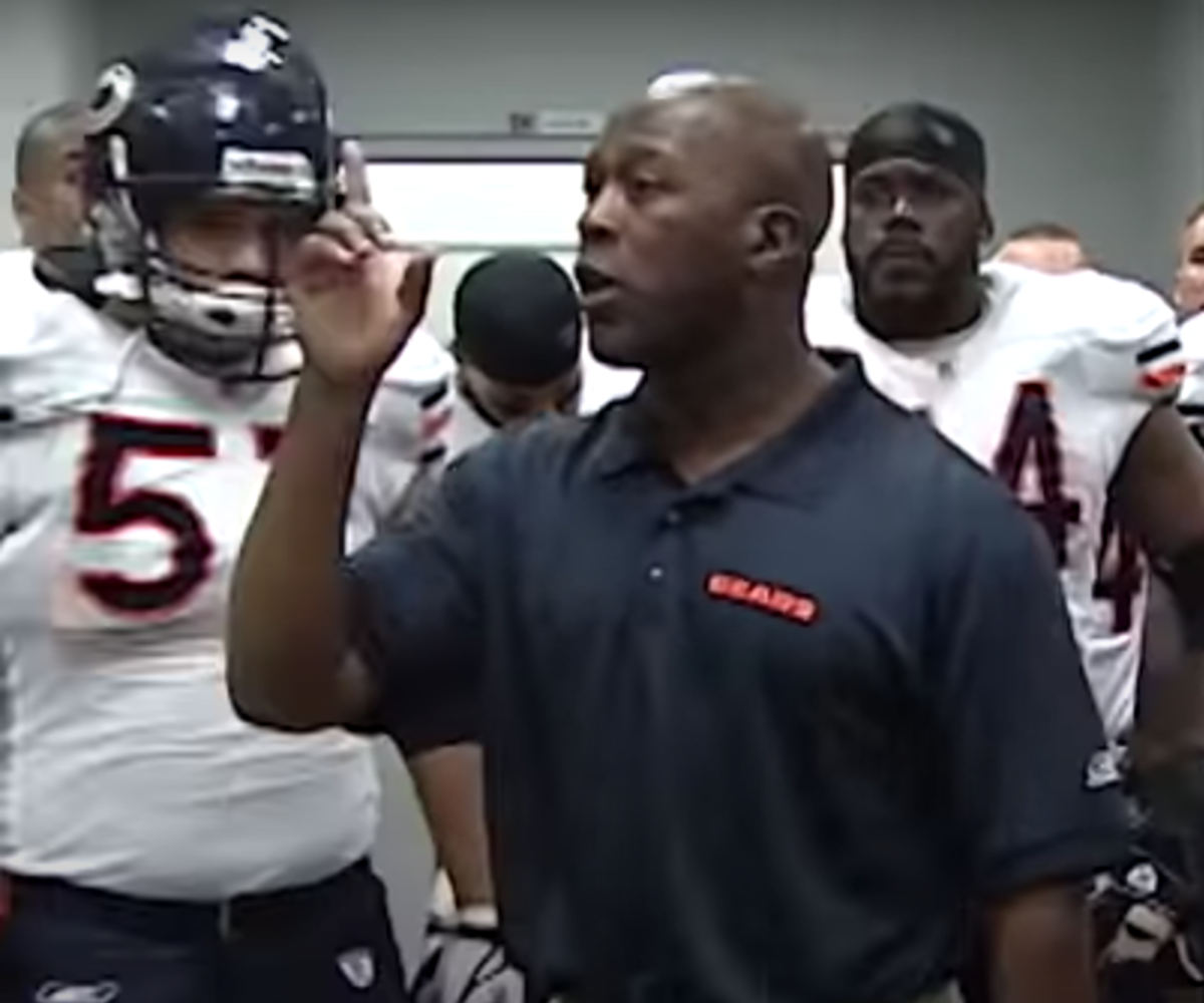 Lovie Smith speaking to the Chicago Bears players, with Olin Kreutz (57) in the background, during halftime of the Monday Night Football comeback win at Arizona in 2006.