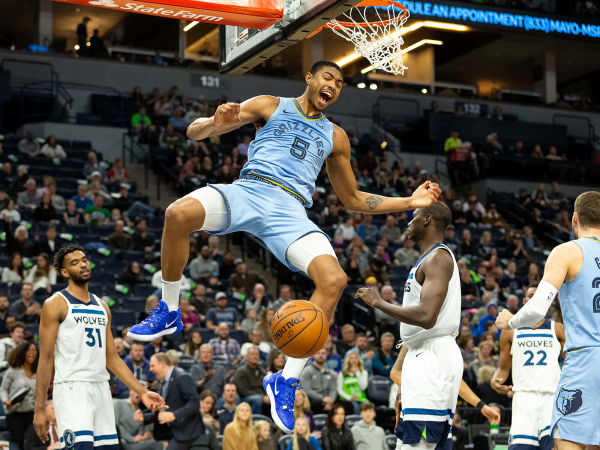 Dec 1, 2019; Minneapolis, MN, USA; Memphis Grizzlies forward Bruno Caboclo (5) dunks the ball during the third quarter against the Minnesota Timberwolves at Target Center. Mandatory Credit: Harrison Barden-USA TODAY Sports