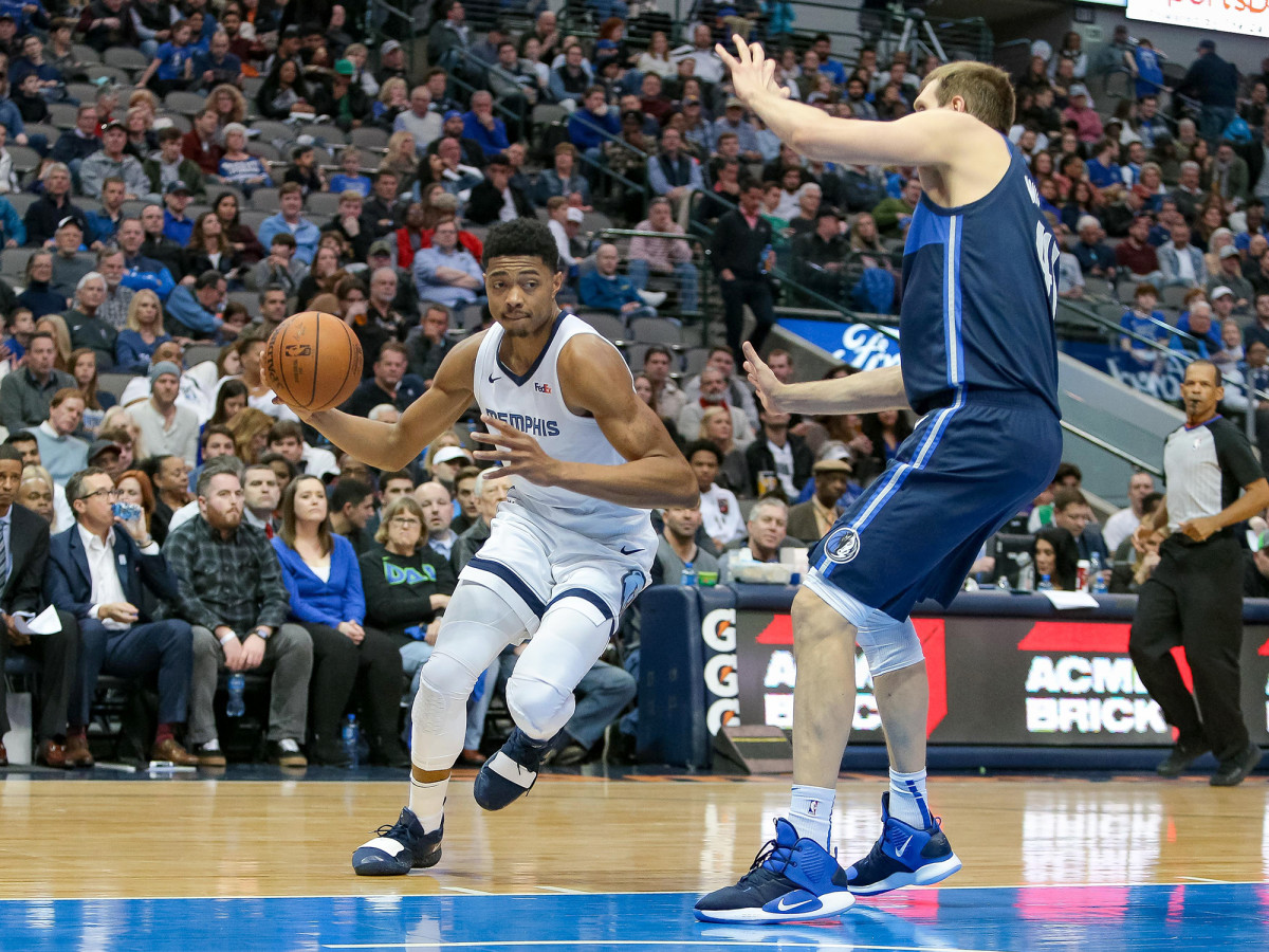 Mar 2, 2019; Dallas, TX, USA; Memphis Grizzlies forward Bruno Caboclo (5) drives to the basket around Dallas Mavericks forward Dirk Nowitzki (41) at American Airlines Center. Mandatory Credit: Andrew Dieb-USA TODAY Sports