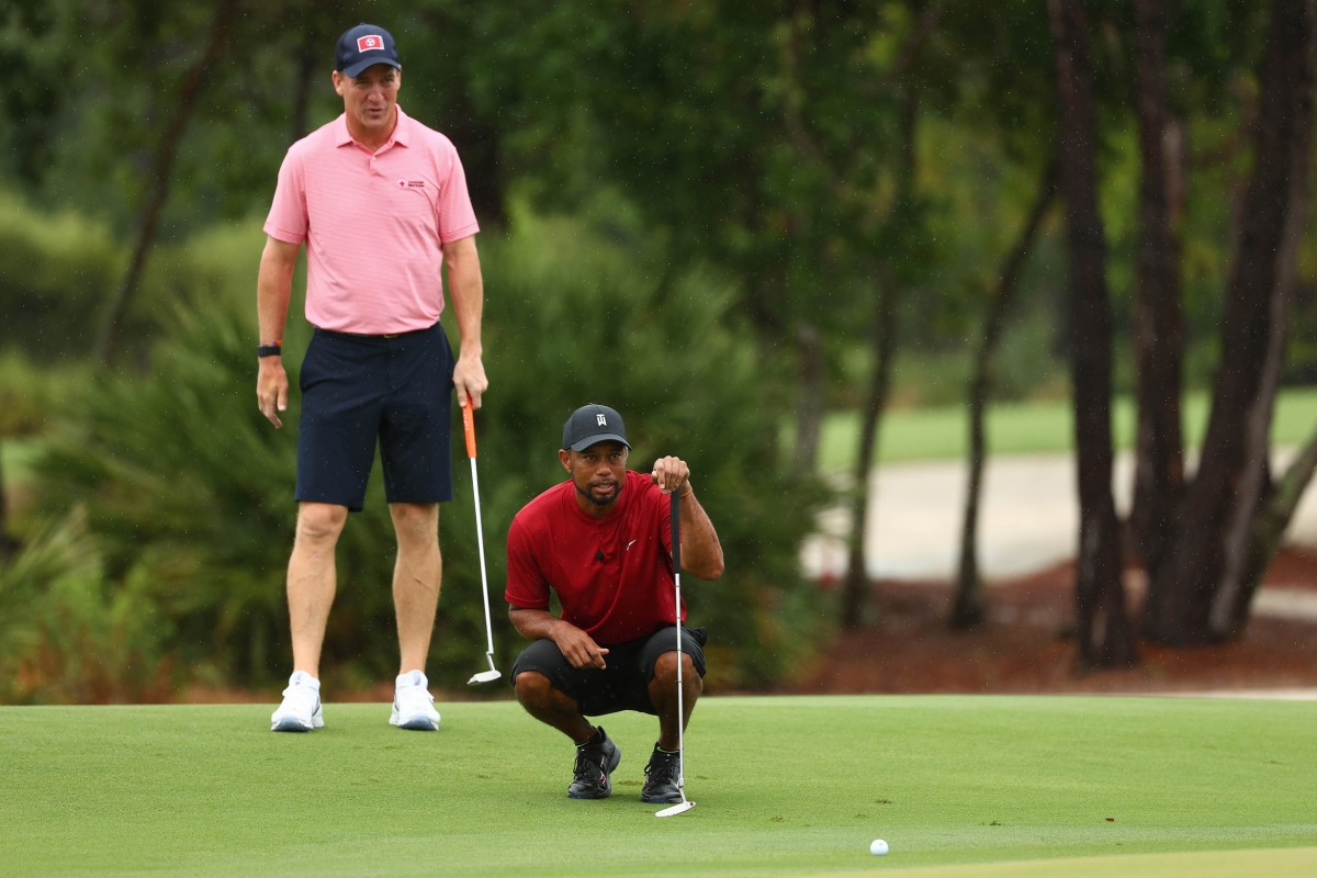 """Peyton Manning (left) watches playing partner Tiger Woods line up a putt in Sunday's """"The Match: Champions for Charity"""" event in Hobe Sound, Fla. Manning and Woods defeated Tom Brady and Phil Mickelson 1-up in a match that raised $20 million for COVID-19 relief efforts."""