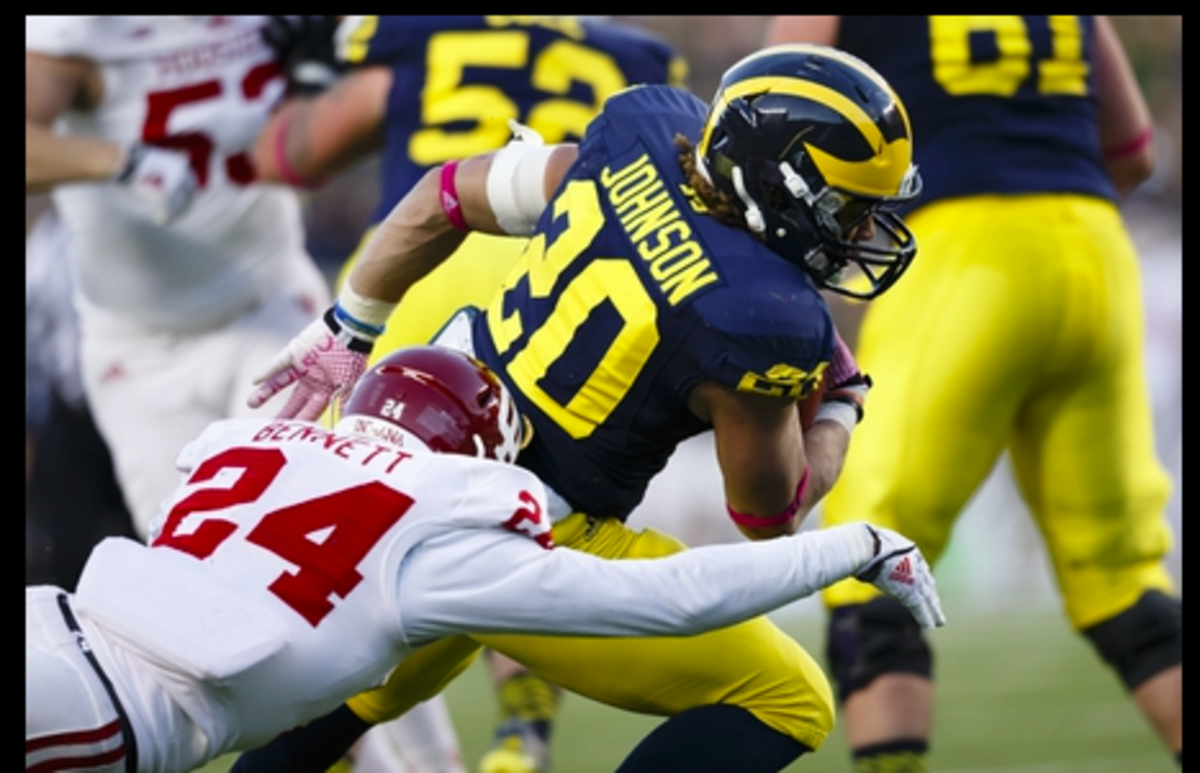 Former Indiana cornerback Tim Bennett makes a tackle against Michigan during a game in 2013. (USA TODAY Sports)