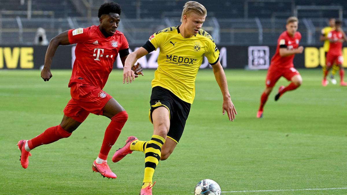Bayern Munich's Alphonso Davies tracks Dortmund's Erling Haaland