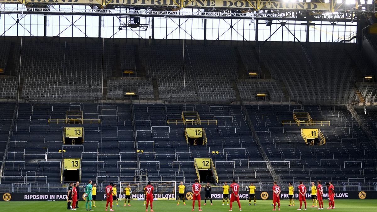 Borussia Dortmund and Bayern Munich observe a moment of silence