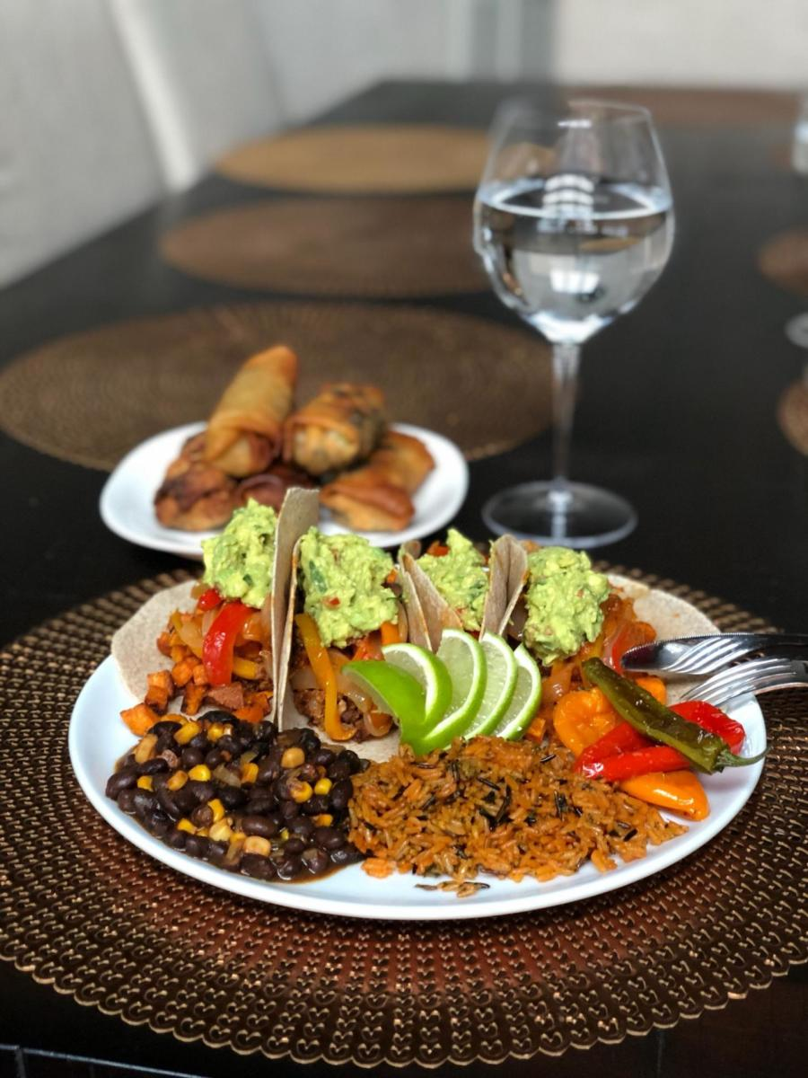 A plate of sweet potato tacos, rice and beans