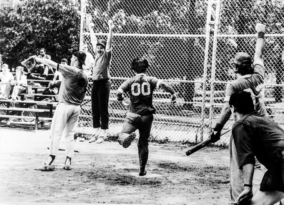 The AP's John Kekis crosses the plate in a 1985 semifinal win over McMane's (left) UPI.