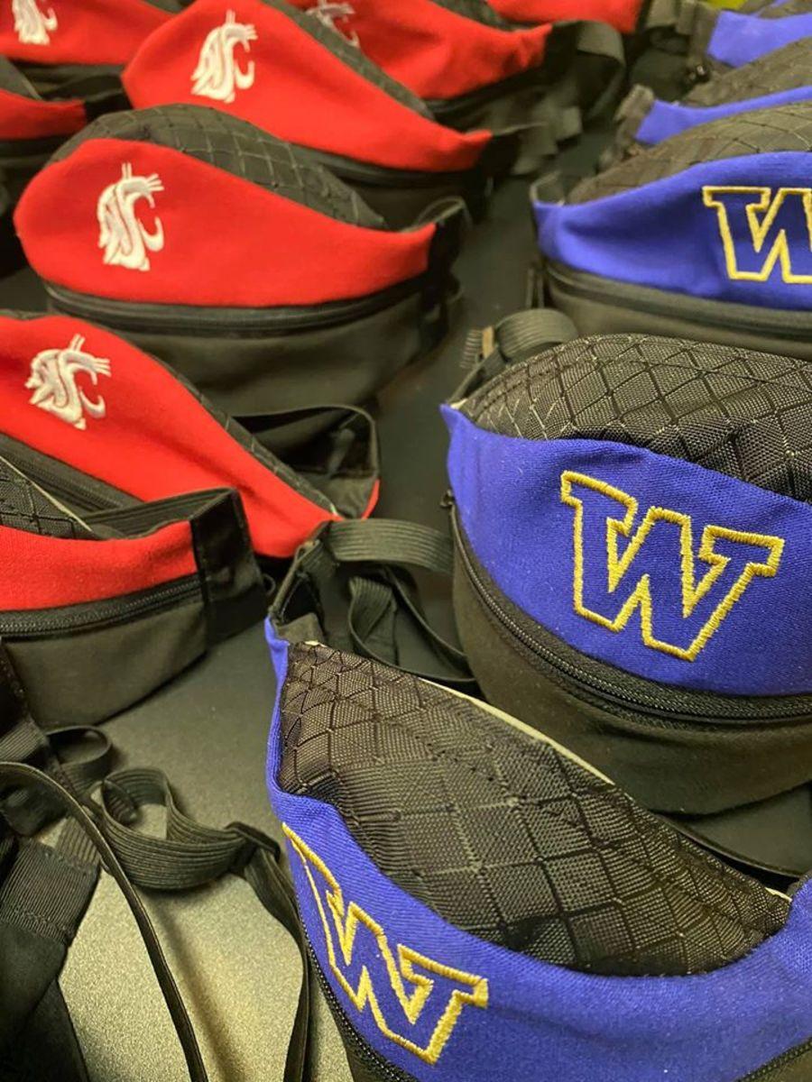 Former Husky defensive lineman Mike Ewaliko makes customized masks.