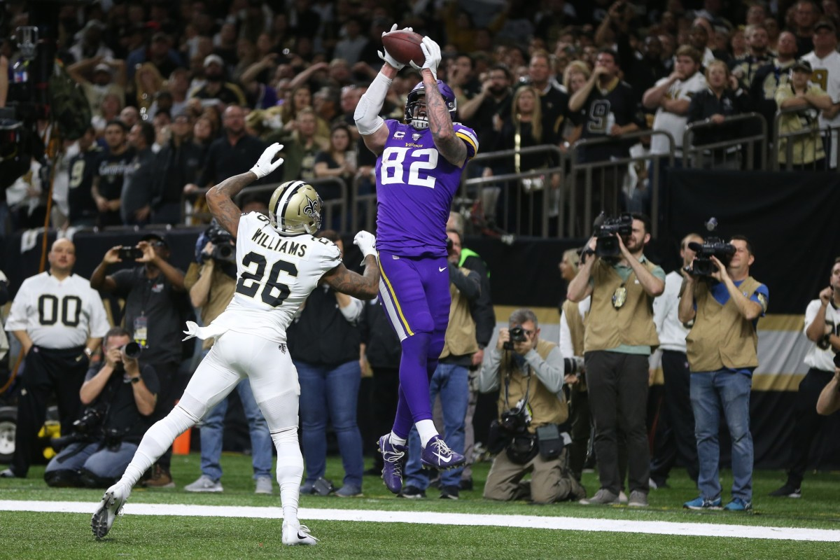 Jan 5, 2020; New Orleans, Louisiana, USA; Minnesota Vikings tight end Kyle Rudolph (82) catches a pass for the winning touchdown over New Orleans Saints cornerback P.J. Williams (26) during overtime of a NFC Wild Card playoff football game at the Mercedes-Benz Superdome. Mandatory Credit: Chuck Cook -USA TODAY Sports