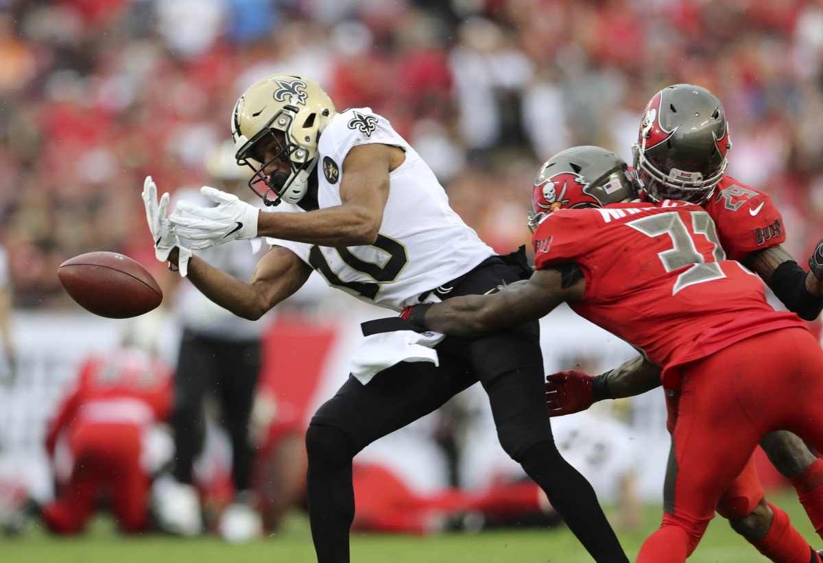 Dec 9, 2018; Tampa, FL, USA; Tampa Bay Buccaneers free safety Jordan Whitehead (31) knocks the ball away from New Orleans Saints wide receiver Tre'Quan Smith (10) during the second half at Raymond James Stadium. Mandatory Credit: Kevin Jairaj-USA TODAY Sports