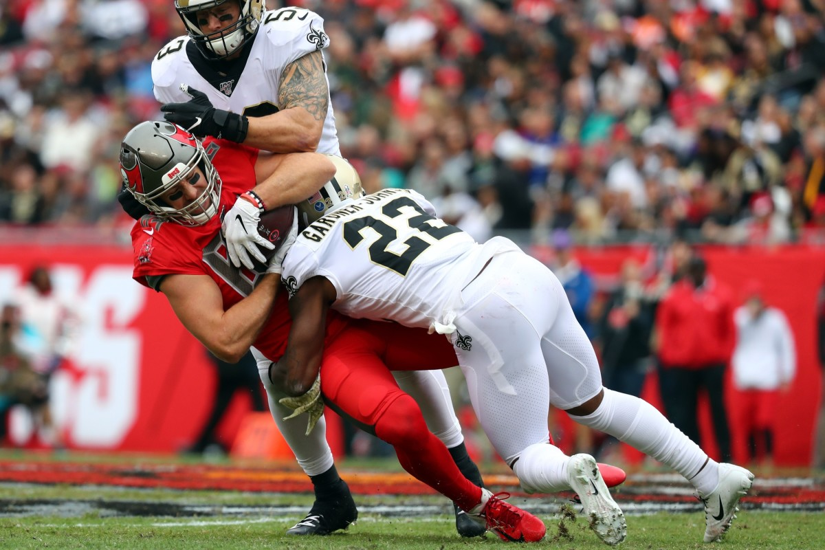 Nov 17, 2019; Tampa, FL, USA; Tampa Bay Buccaneers tight end Cameron Brate (84) catches the ball against New Orleans Saints outside linebacker A.J. Klein (53) and defensive back Chauncey Gardner-Johnson (22) during the first half at Raymond James Stadium. Mandatory Credit: Kim Klement-USA TODAY Sports