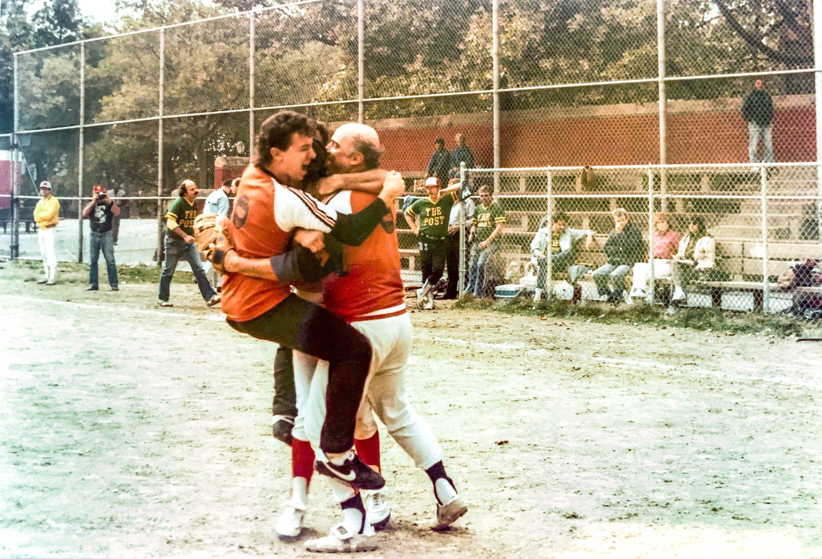 McMane (right) and UPI teammate Joel Sherman celebrate winning the 1984 title over the Post (for whom Sherman is now a baseball columnist) at the league's alternate field on 54th St. and 11th Ave.