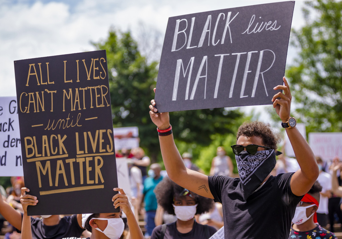 Trae Young protests at a rally in Norman on Monday, June 1, 2020.
